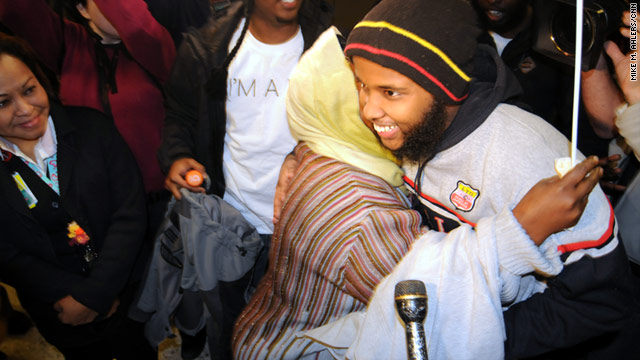 Gulet Mohamed, 19, of Alexandria, Virginia, is greeted by family and supporters Friday upon his return to the United States.