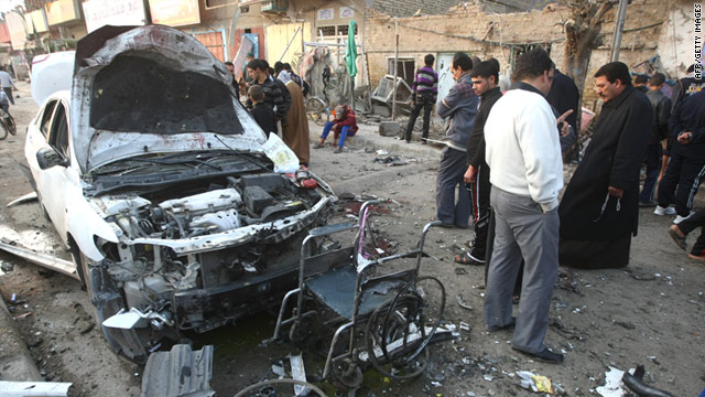 Iraqis gather at the scene of the car bomb that detonated during a funeral ceremony in Baghdad