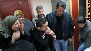 Palestinian relatives cry near the body of Maher Qadus, 18, after he was brought into a hospital in the West Bank.