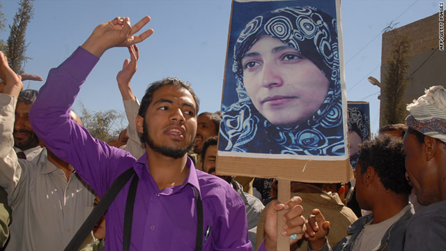 Pprotesters, holding up pictures of detained activist Tawakkol Karman, demonstrate in Sanaa on Jan. 24, 2011.