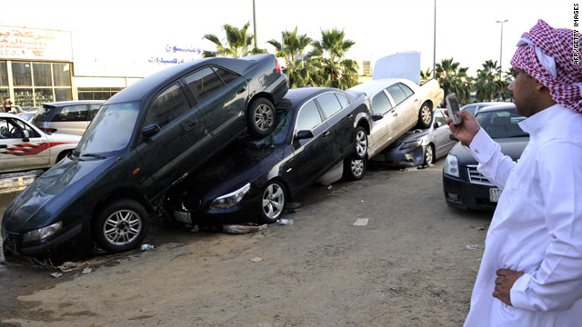 Vehicles are piled up following heavy rains and floods in Jeddah, Saudia Arabia on January 27, 2011.