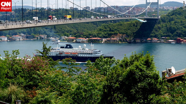 Seen from the European side of the Bosphorus, a ship passes under the Fatih Sultan Mehmet Bridge in Turkey.