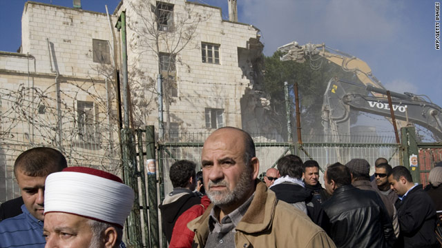 Palestinians protest as Israeli bulldozers demolish a hotel to make way for Jewish settlements in the Sheikh Jarrah neighborhood.