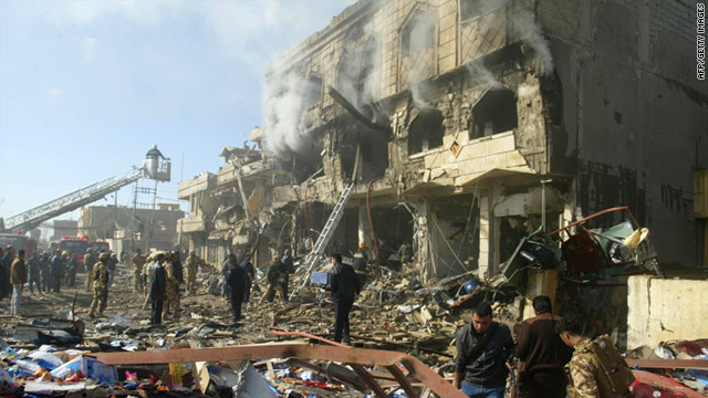 Iraqis inspect the scene following three near-simultaneous car bomb explosions Wednesday in the northern city of Kirkuk.