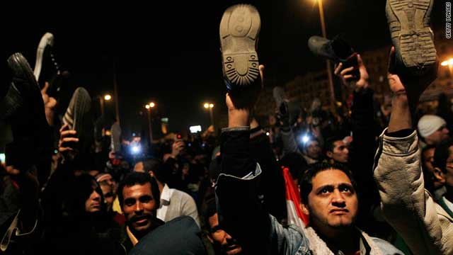 Anti-government protesters react after Egyptian President Hosni Mubarak made a statement February 10, 2011.