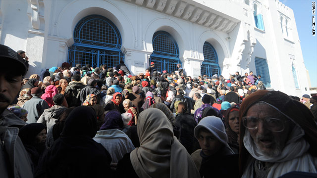People wait in front of the Social Services Ministry to get financial help in Tunis, Tunisia.