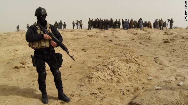 Iraqi authorities uncovered a mass grave with 153 bodies of Al-Qaeda victims, many of them women, children and members of the security forces, police said.