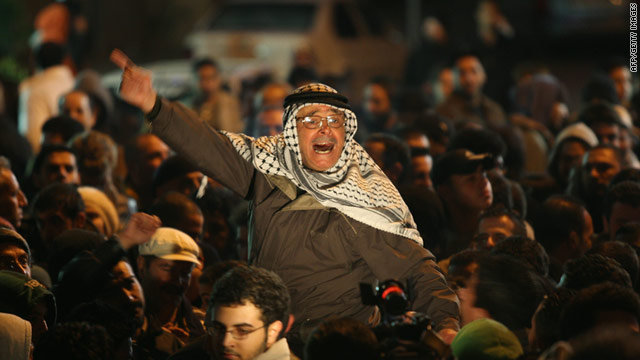 Palestinians in Ramallah on the West Bank celebrate the ouster of Egyptian President Hosni Mubarak on Friday night.