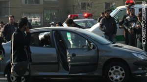 Police in November investigate the scene of a car bombing in which Fereydoun Abbasi was targeted.
