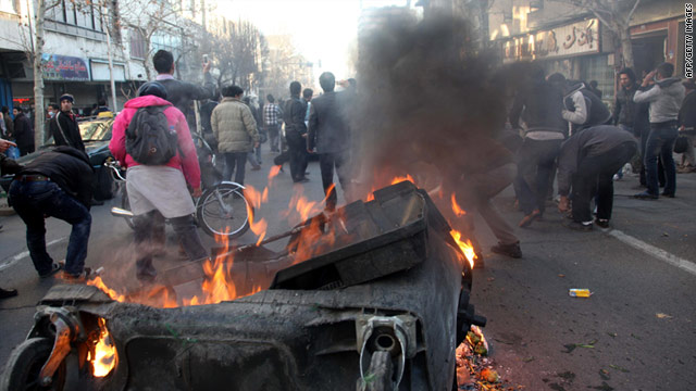A garbage container is set on fire as Iranian protesters stage an anti-government demonstration in Tehran on February 14.