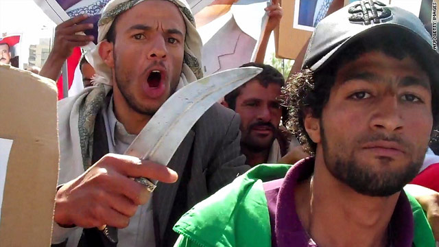 A supporter of Yemen's president holds a dagger as pro-government protesters face students demanding change on Feb. 16.