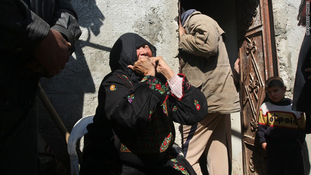 A relative of one of the three Palestinians who were shot dead by Israeli forces cries during his funeral in Gaza.