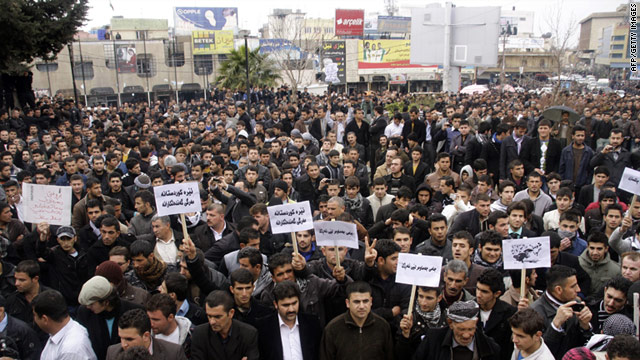 Iraqi Kurdish anti-government protesters march in the city of Sulaimaniya on Thursday.