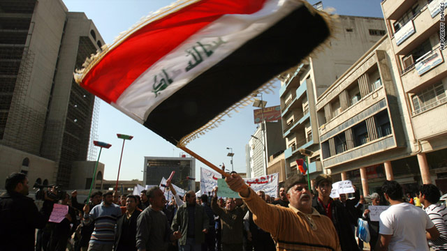 Iraqi men protest against corruption in central Baghdad on February 18, 2011.