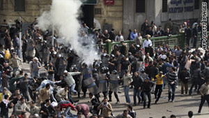 Riot police disperse crowds in Tahrir Square on January 28, 2011.