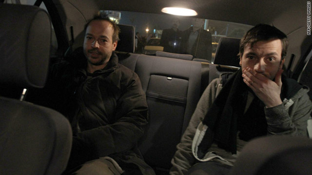 German reporters Marcus Hellwig and Jens Koch arrive at Tehran's Mehrabbad Airport from Tabriz on February 19, 2011.
