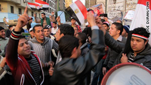 Egyptians march in Tahrir Square in Cairo during the 18-day protests.