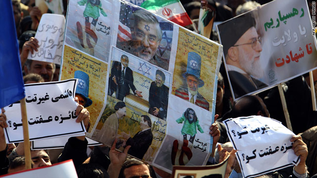 Thousands of regime loyalists marched on February 18 to demand that Mehdi Karrubi and Mir Hossein Moussavi be hanged.