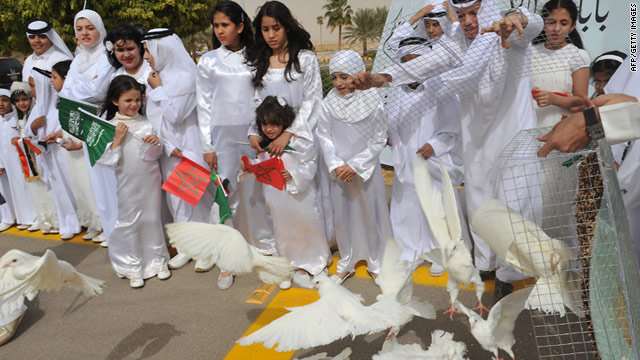 Saudis release white doves as they greet the convoy transporting King Abdullah upon his return to Riyadh on Wednesday.