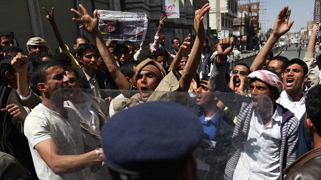 A Yemeni soldier stands guard in front of anti-government protesters during a demonstration in Sanaa on Wednesday.
