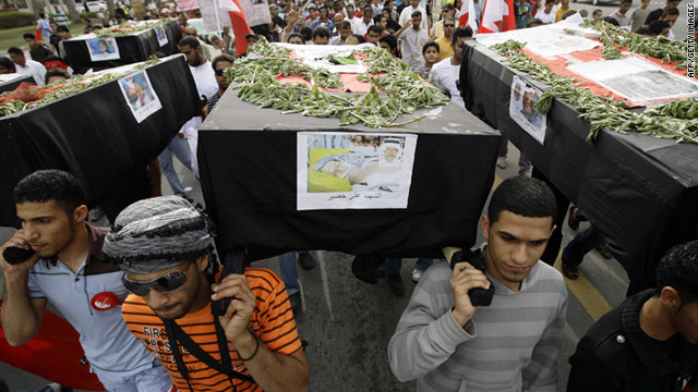 Protesters carry symbolic coffins Thursday in remembrance of 7 people who were killed in police crackdowns in Bahrain.