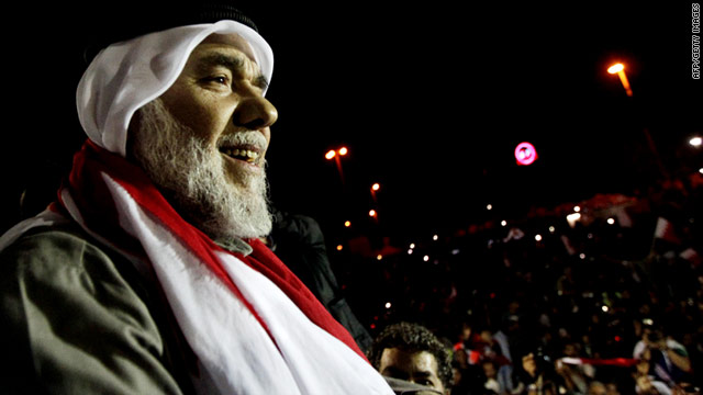 Bahraini Shiite opposition leader Hassan Mashaima greets anti-government protesters gathered at Pearl Square in Manama on Saturday, February 26, upon his return from self-imposed exile.