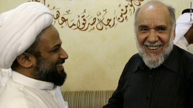 Opposition party leader Hassan Mushaimaa, right, is greeted by clerics Saturday upon his return to Bahrain from exile.