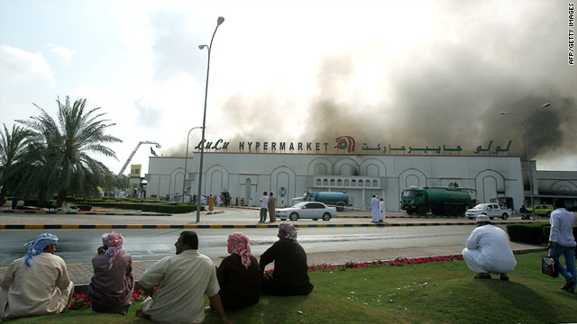 Omani protesters continue to call for more jobs as a hypermarket burns during a demonstration in the town of Sohar. Some believe police killed two protesters for burning shops and cars in the town.