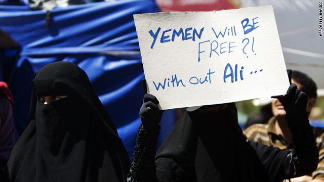 A Yemeni anti-government protester holds a banner during a demonstration for the ouster of President Ali Abdullah Saleh in Sanaa on February 28.