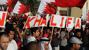 Bahraini Shiite protesters march in an anti-regime demonstration in Manama on Friday.