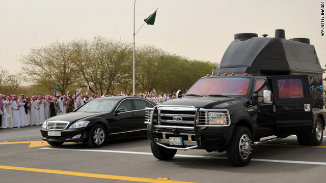 File photo shows Saudi people greeting a convoy transporting King Abdullah in capital Riyadh on February 23.