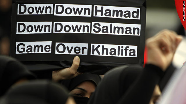 A Bahraini protester holds an anti-government sign during a rally at Pearl Square, Manama on March 1, 2011.