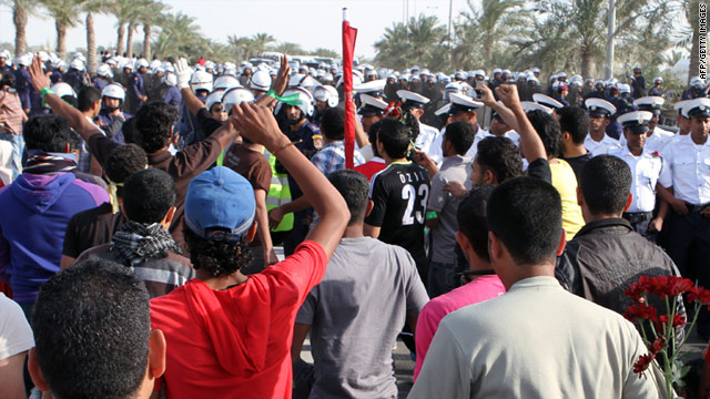 Bahraini anti-government protesters face police forces who tried to prevent clashes with armed loyalists in Riffa on Friday.