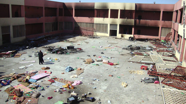Prisoners set fires in cells that hold hundreds of inmates in a prison in Tikrit, Iraq, on Sunday.