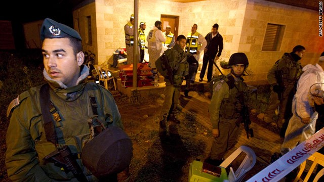 Israeli soldiers block access to a house where five Israelis were murdered in the Jewish settlement of Itamar on Saturday.