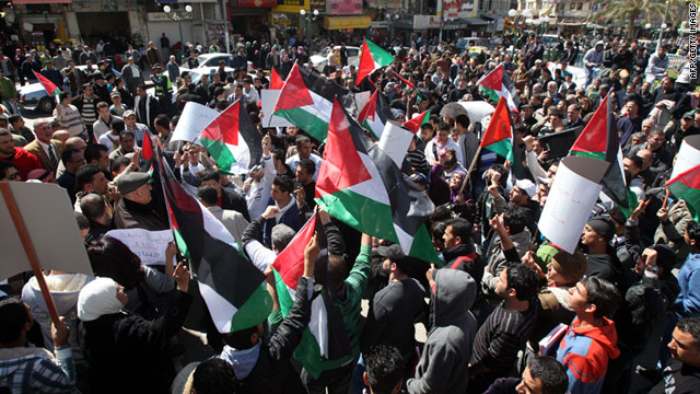 Palestinians demonstrate for unity between Fatah and Hamas in Nablus in the northern West Bank on Tuesday.