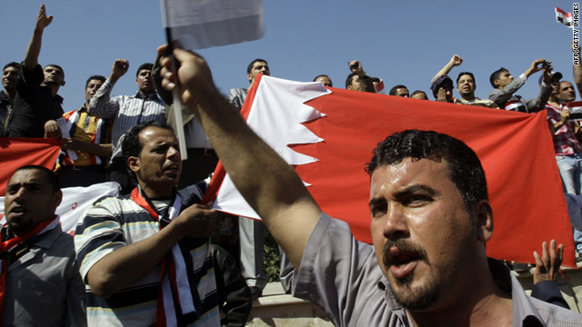 Iraqi demonstrators denounce a crackdown on Shiite-led demonstrators in Bahrain in Baghdad on Friday, March 18.