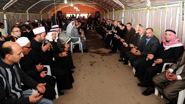 A picture from the Syrian Arab News Agency shows Syrians attending a condolences meeting Sunday in the city of Daraa, which is near the border with Jordan.