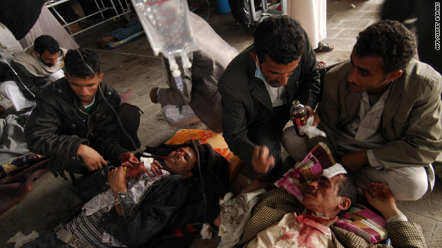 Yemeni medics treat wounded anti-government protesters after a security crackdown in Sanaa March 18, 2011.