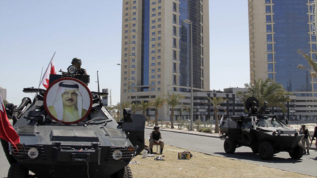 A picture of King Hamad decorates a tank deployed in Manama's Pearl Square after a recent crackdown against protesters.