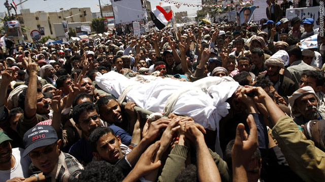 Protesters carry the body of a comrade who was among dozens killed in last week's violent crackdown on protests in Yemen.
