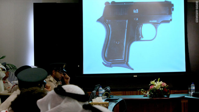 Dubai police display one of the 16,000 pistols made in Turkey and seized from a shipping container bound for Yemen.