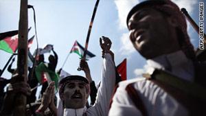 Jordanian government supporters gather in front of the old palace Saturday in Amman.