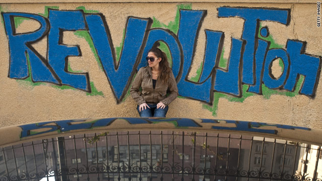 An Egyptian woman stands in front of graffiti in Cairo's Tahrir Square.