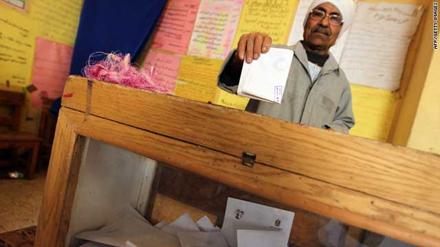 An Egyptian man casts his vote on constitutional changes at a polling station in Mansura on March 19, 2011.