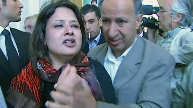 Eman al-Obeidy is taken out of the Rixos Hotel in Tripoli. She has not been seen since.