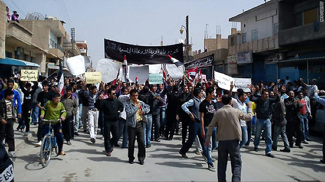 Thousands of anti-government protesters march in the northeastern Syrian town of Kamishli after prayers on Friday.
