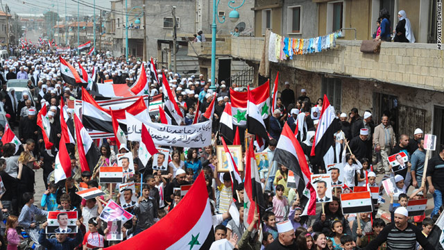 Druze Syrians in the Golan Heights march Saturday in support of President Bashar al-Assad.