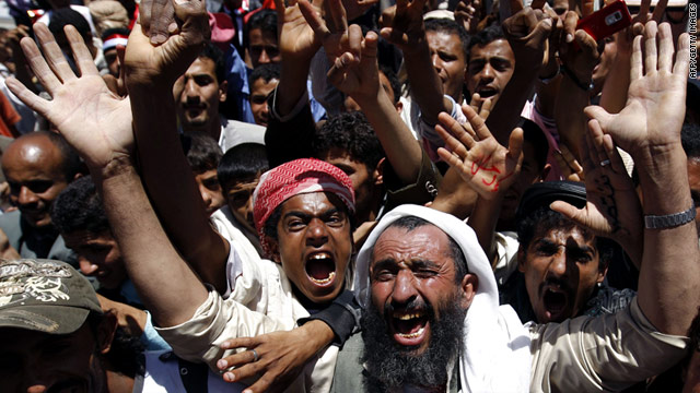 Protesters shout anti-government slogans in Sanaa, Yemen, on Sunday.