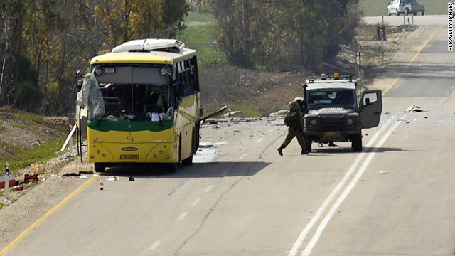 An Israeli teenager was wounded when militants fired a missile at an Israeli schoolbus traveling near the Gaza border.